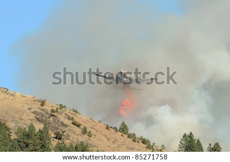 Large air tanker dropping fire retardant at a working  natural cover fire near Roseburg Oregon