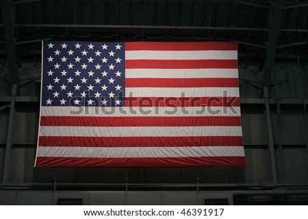 Large American flag in Warehouse - stock photo