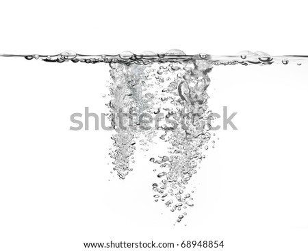 large amount of air bubbles in water isolated on white background - stock photo