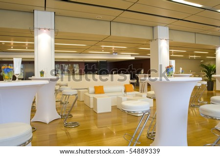 Large and beautiful decorated conference room with white sofas and tables - stock photo