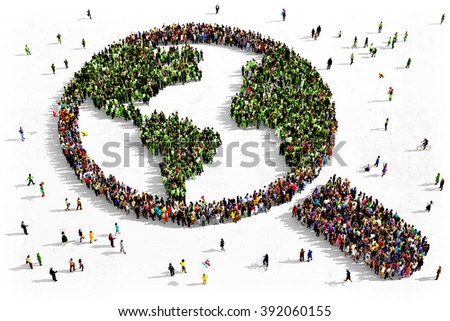 Large and diverse group of people seen from above gathered together in the shape of a magnifying glass searching the earth - stock photo