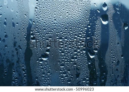 large and fine water drops on glass