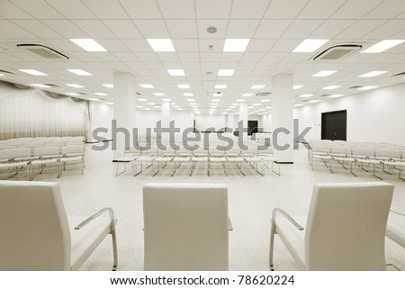 large and modern white auditorium with curtains