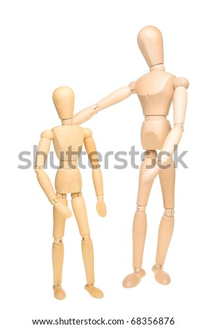 Large and small male manikins standing side by side isolated against white