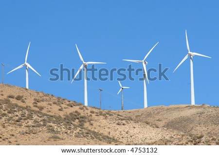 Large and small windmills. - stock photo
