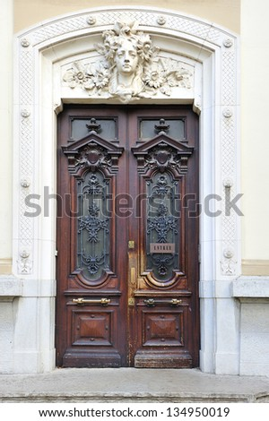 Large and stately wooden doors by the Lyon, France - stock photo