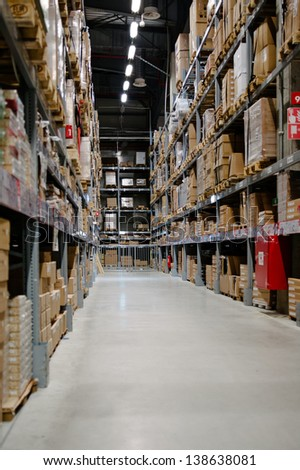 Large and tall full warehouse full of boxes and goods - stock photo