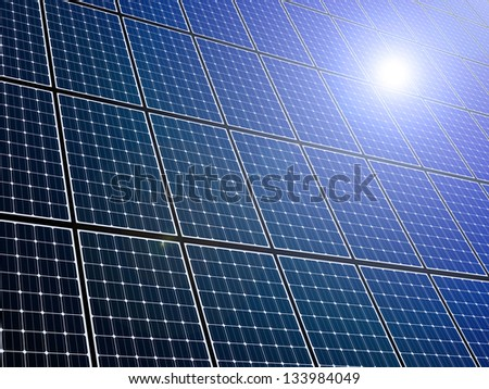 Large array of solar panels with sunlight reflection - stock photo