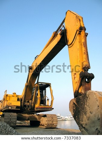 Large Backhoe -- with a large articulated arm and digging bucket