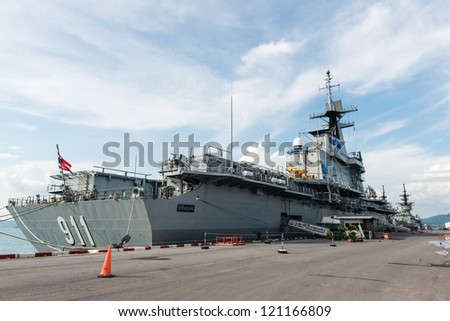 Large battle ship in Naval base, taken on a sunny day