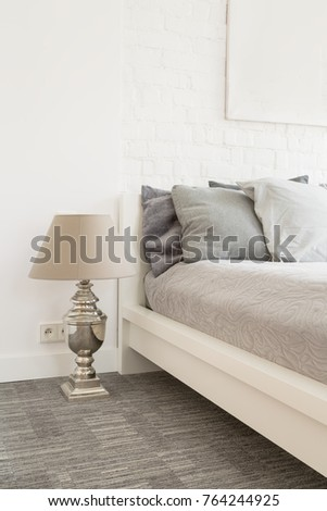 Large bedroom in bright colors with a comfortable double bed