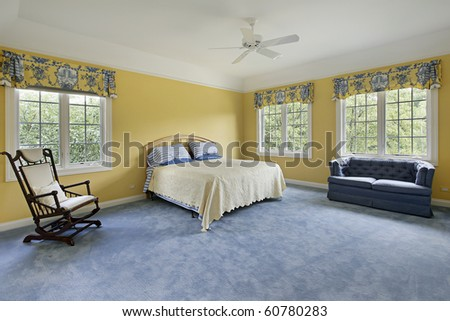 Large bedroom in home with yellow walls - stock photo