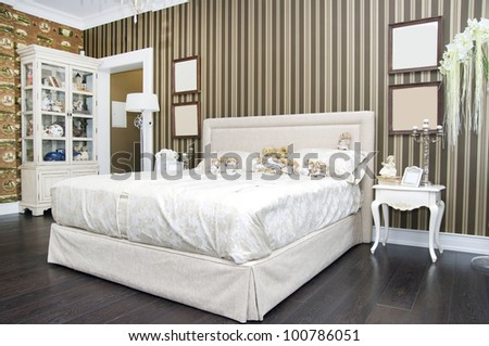 large bedroom with bedside tables and bed - stock photo