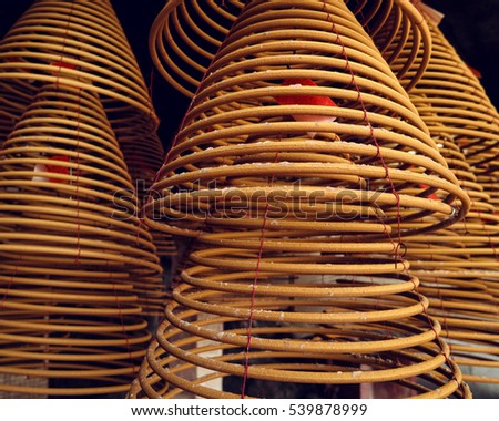 Large Bell Shaped Spiral Incense Coils in Chinese temple.