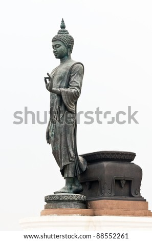 Large black statue of Buddha in the white background.