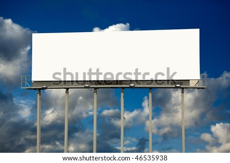 Large blank billboard against cloudy sky