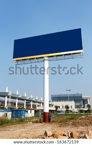 Large blank billboard in the small town
