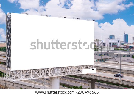 large blank billboard on road with city view background. - stock photo