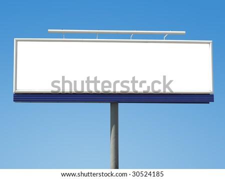 Large blank panoramic billboard shot over blue sky - stock photo