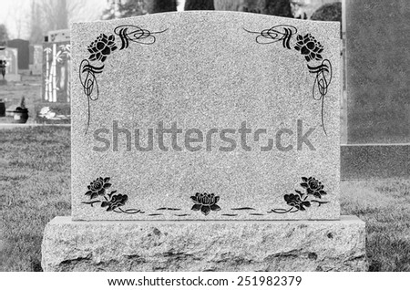 Large blank tombstone in the cemetery  - stock photo