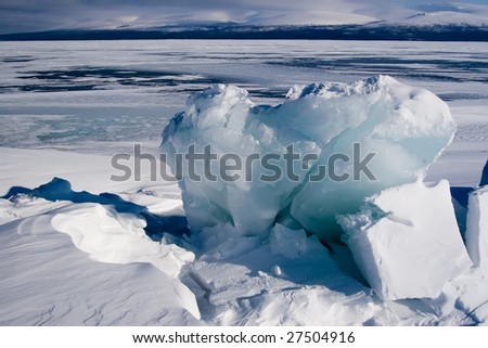 Large block of ice on the surface of a lake