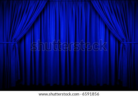 Large Blue curtain with spot light and fading into dark.