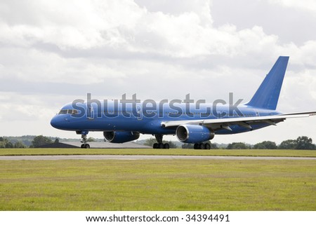 large blue passenger jet aircraft on runway for take off