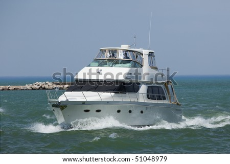Large boat coming into port - stock photo