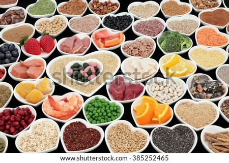 Large body building and health high protein super food with meat, fish, dairy, pulses, cereals, grains, seeds, supplement powders, vitamin pills, fruit and vegetable  selection. Selective focus, - stock photo