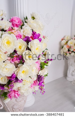 large bouquet of flowers in a vase at room