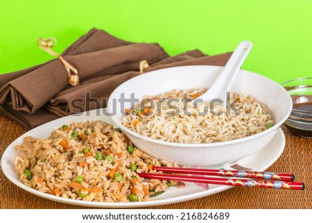 Large bowl of Chinese Noodle Soup on plate with combination fried rice. - stock photo