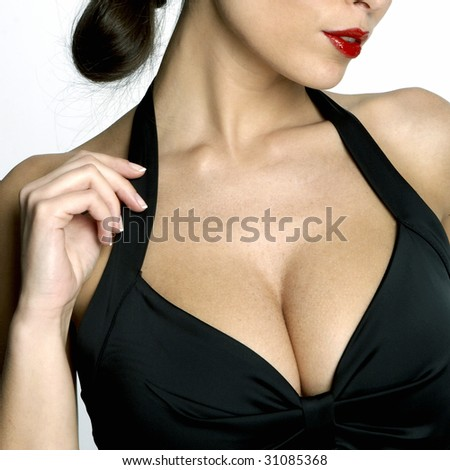 Large breasted woman in a black dress