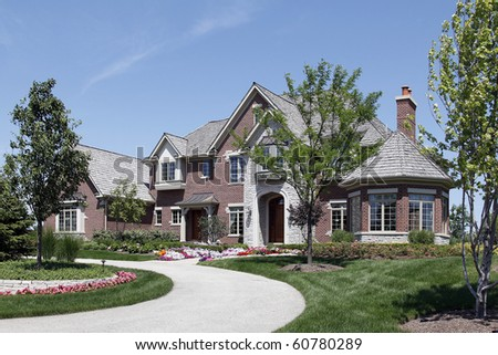 Large brick home in suburbs with stone entry - stock photo