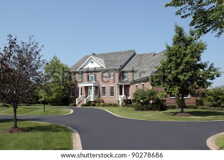 Large brick home with covered entry - stock photo