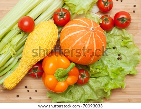 Large bright assortment of fresh vegetables on a cutting board