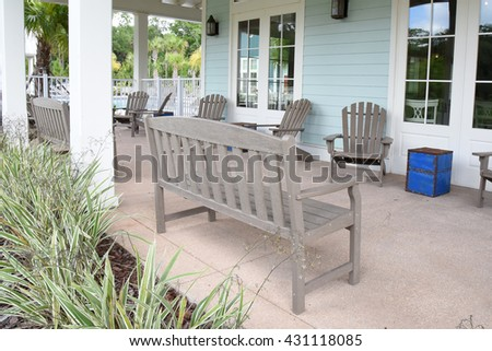 Large brown bench on a big porch
