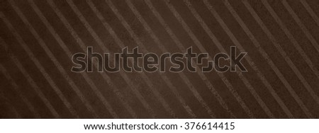 large brown striped background with vintage texture, diagonal slanted stripes with faded grainy texture, old wallpaper pattern design - stock photo