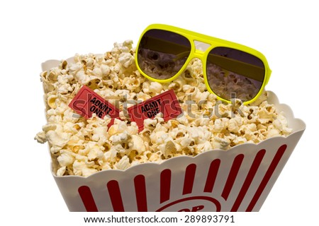 Large bucket of popcorn with red tickets and sunglasses/ Going To The Movies In The Summer - stock photo