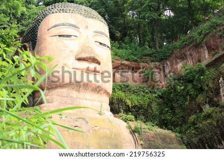 large buddha statue in Leshan, Sichuan, China (it is carved out of mountain and 71 meter tall)  - stock photo