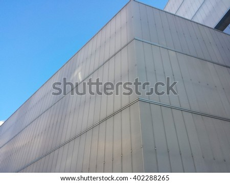 large building of modern architecture, in white plastic