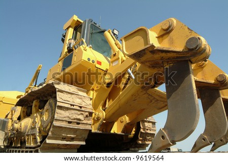 Large bulldozer perspective in construction site - stock photo