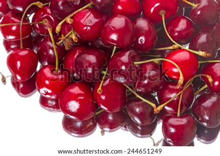 Large bunch of cherries on a white background - stock photo