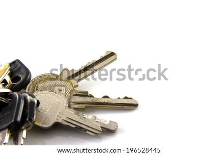 Large bunch of keys isolate on white background