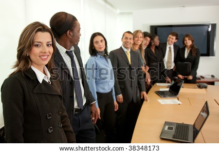 Large business group in a conference smiling - stock photo