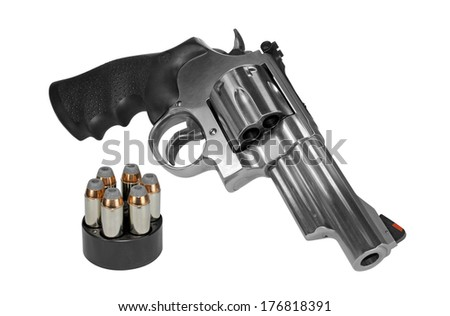 Large caliber revolver with speedloader - stock photo