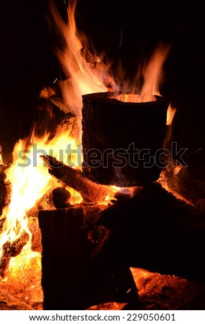 Large camp fire on a warm summer night - stock photo