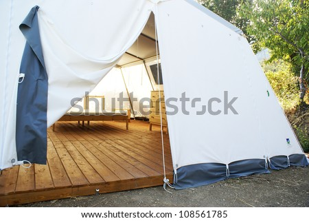 Large camping tent open. visibilie the interior - stock photo