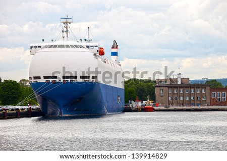 Large car carrier ship in port.