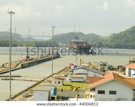 Large cargo ship about to enter the Miraflores lock on the Panama Canal. Panama, Central America.