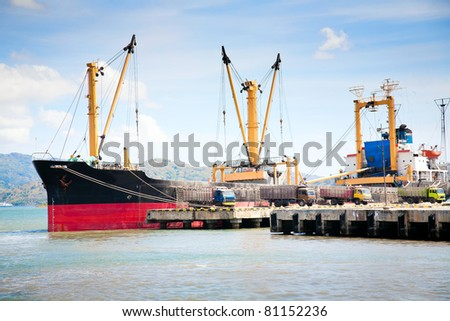 Large cargo ship docked in port - stock photo